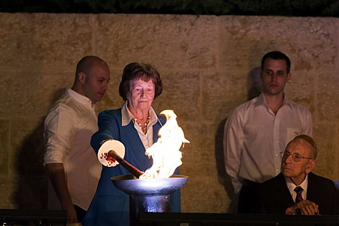 Holocaust survivor Dita Kraus lights a torch during a ceremony at the Yad Vashem Holocaust Memorial Museum in Jerusalem, as Israel marks the annual Holocaust Remembrance Day on April 27, 2014. Photo by Yonatan Sindel/Flash90