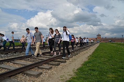 Jewish youth from all over the world participating in the March of the Living  walk the tracks at the Auschwitz-Birkenau camp site in Poland. (illustrative)