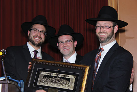 Yeshiva Day School of Las Vegas's deans, Rabbi Moshe Katz and Rabbi Zev Goldman, present award to Educator of the Year, Rabbi Michoel Paris.