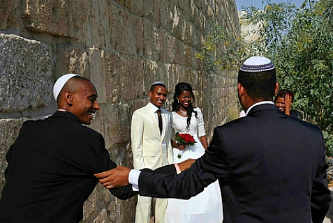 Loving couple next to the Old City Walls in Jerusalem, prior to their wedding. August 13, 2013.