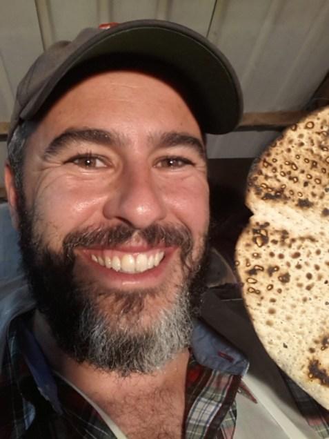 Yishai Fleisher baking matzah in Beit El by hand.