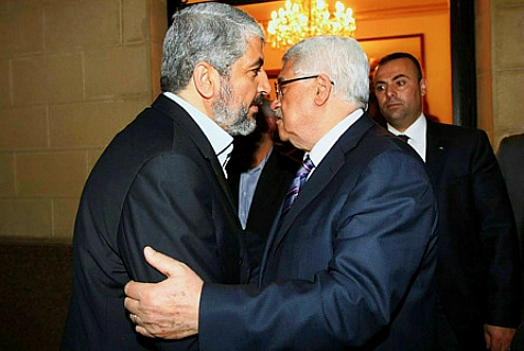 Palestinian Authority leader Mahmud Abbas (R) meets with Hamas leader, Khaleed Meshaal (L) in Cairo on February 23, 2012. They were hugging about an earlier unity deal that failed.