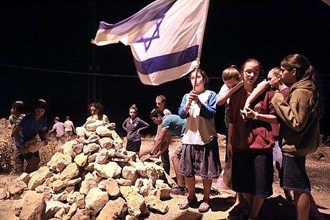 "Jewish children build an ""Andarta"", a monument, outside Halhul, near where the boys bodies were found buried."