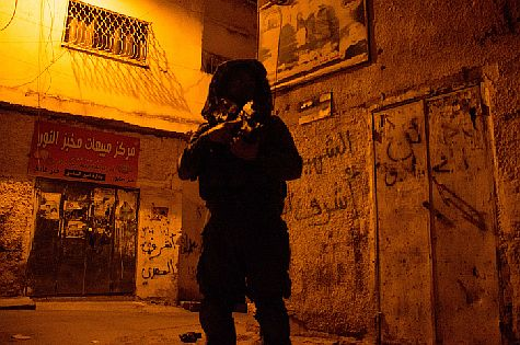 An IDF soldier from the Givati Brigade on another overnight search, this time in Jenin,  as the hunt continues for three Israeli teens kidnapped by Arab terrorists on June 12.