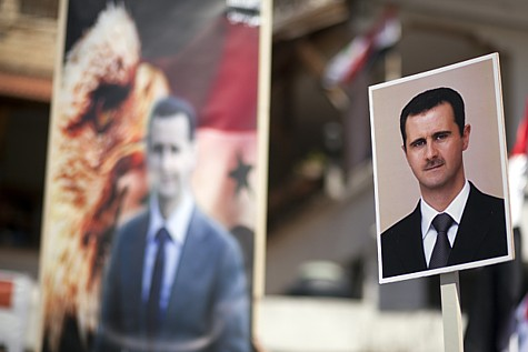 Posters of Syrian president Bashar al-Assad. A Syrian war plane crashed while carrying out strikes against ISIS on Sept. 16, 2014.