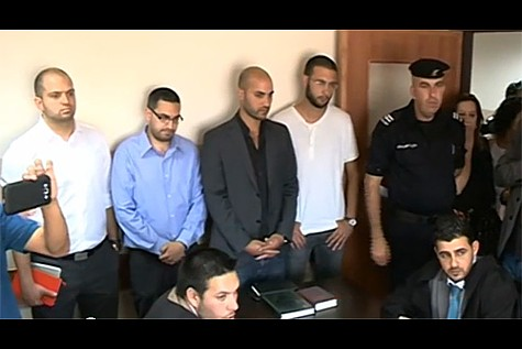 The four Palestinian BDS activists stand during their court appearance in Ramallah.