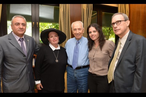 Jonathan Pollard's wife Esther Pollard (2L)  meets with Israel's President Shimon Peres (C), Ayelet Shaked (2R), and Nahman Shai (R) and at the president residence in Jerusalem on June 22, 2014.