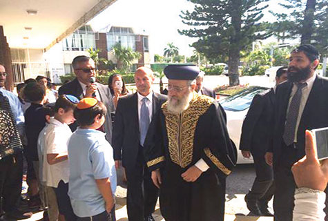 Chief Rabbi Yosef greets students at RASG Hebrew Academy.