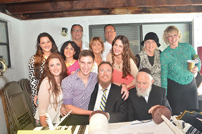 Family of Harry Berger celebrating the new Sefer Torah dedicated to his memory.
