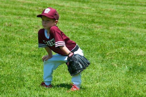 Little League player steadies himself. (illustrative photo only)