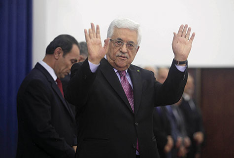 Mahmoud Abbas waves during the swearing-in ceremony of the new unity government in Ramallah on June 2.