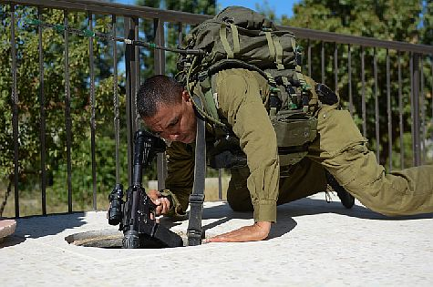Judea Regional Brigade soldier searches for three yeshiva boys kidnapped by terrorists and missing since June 12.