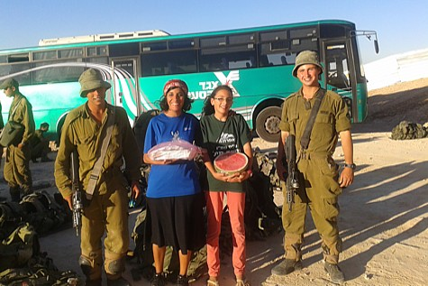 Soldiers greeted as they get off the bus in Efrat. Photo by: Michal Haber