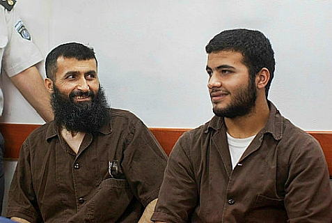 Ziad A-wad and his son (R) in Israeli Military court, June 23, 2014.