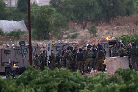 IDF soldiers in Halhul. Bodies of three kidnapped Israeli teens discovered in nearby field.