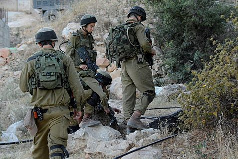 Israeli soldier search the Hebron area for clues of the fate of three kidnapped Jewish yeshiva students