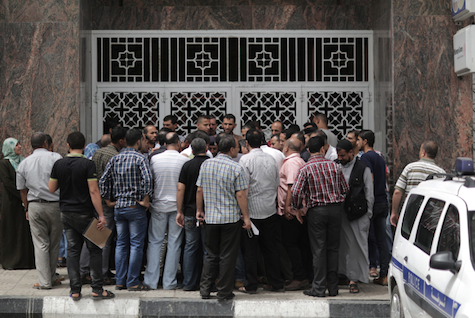 Palestinian government workers gather to receive salaries, June 5, 2014