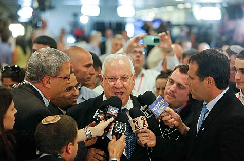 Israeli presidential candidate and former Knesset Speaker MK Reuven Rivlin speaks with media during vote for president, June 10, 2014.