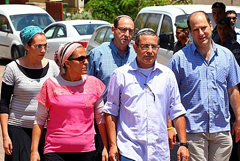 Ofir (C) and Bat-Galim Shaar (rear, L), parents of kidnapped Jewish teenager Gilad Sha'ar, seen with Iris ( front L) and Ouria Yifrah (front, center), parents of kidnapped Jewish teen Eyal Yifrah, and Avi Frenkel (R), father of kidnapped Jewish teen Naftali Frenkel.