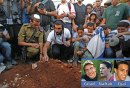 Mourners place rocks on the graves of three murdered Israeli teens after a joint funeral service in Modiin on Tuesday.