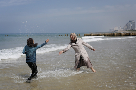 Arab women from Bethelehem play on the beach in Tel Aviv, March 23, 2014