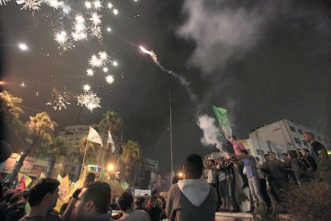 Arabs in Ramallah celebrating rumors of a kidnapping.