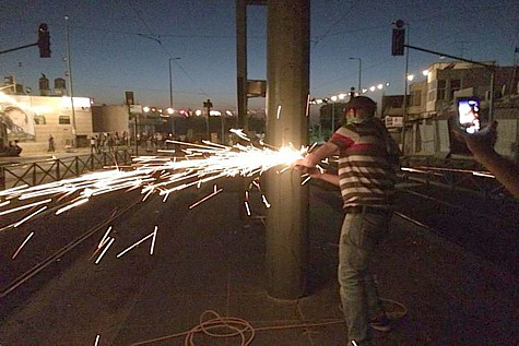 Arabs cut down the Jerusalem Light Rails electric poles.