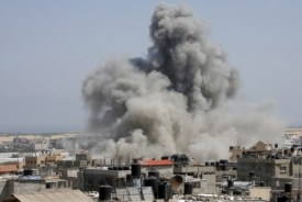 Missile hits an area in Rafah, southern Gaza Strip,, July 9, 2014