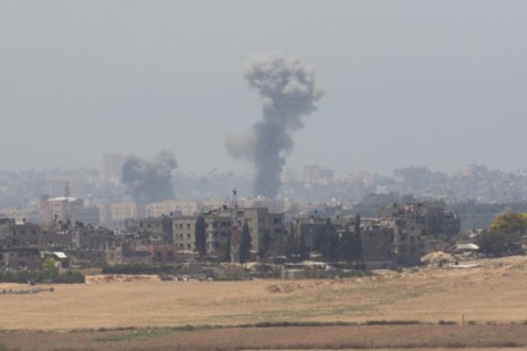 Smoke rises from Gaza after an Israeli air strike July 10, 2014.