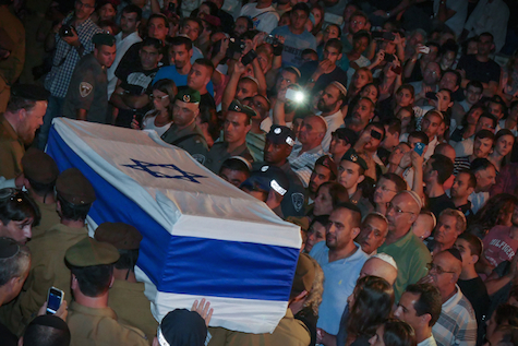 Tens of thousands of Israelis accompany lone IDF soldier Sean Carmeli to his final resting place.
