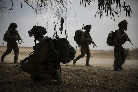 IDF soldiers train ahead of combat in Gaza, July 22, 2014.