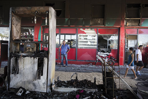 The scene of a gas station in Ashdod that was hit directly by rocket fire from Gaza on the fourth day of Operation Protective Edge. The rocket caused explosions and three people were injured, one of them critically.