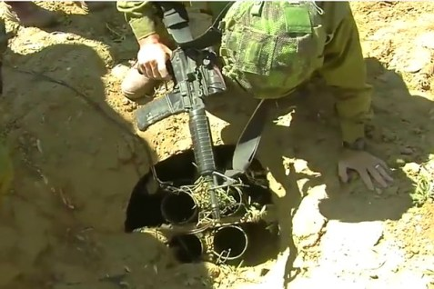 Paratroopers uncover a hidden rocket launcher in Gaza.