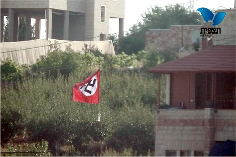 Nazi flag proudly waves over Arab town.