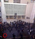 Jews inside Paris synagogue surrounded by protesters throwing rocks, holding bats and chairs.
