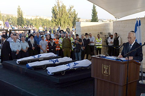 United in grief: President Shimon Peres eulogizes the three murdered Jewish boys, whose bodies were found in a field near Karmei Tzur.,  July 1, 2014.