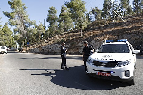 Israeli police in the Jerusalem forest, near where the murdered Arab boy's body was found.