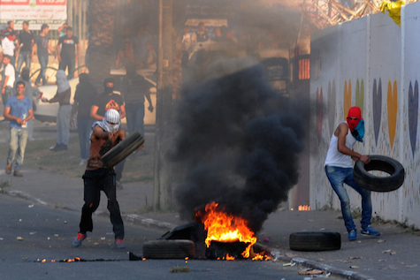 Palestinians clash with Israeli border police during clashes in Wadi Ara, Israel , July 5, 2014