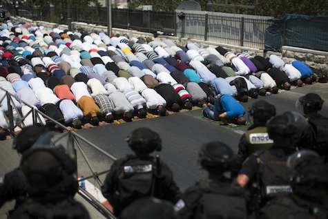 Israeli police protect Muslims at prayer on first Friday of Ramadan. Somehow, the photo never made it to the international media.