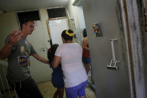 Children run into a shelter during a Code Red siren warning of incoming rockets fired from Gaza in the southern Israeli city of Ashkelon.