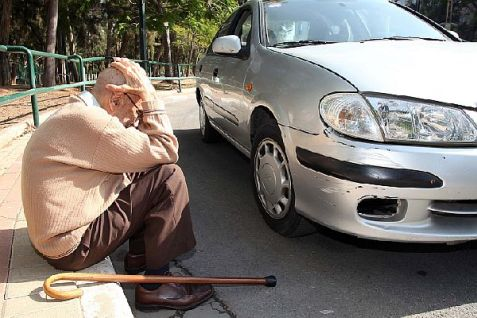 An elderly man takes cover when a Code Red rocket alert warns of an incoming Hamas M75 missile attack on Tel Aviv.