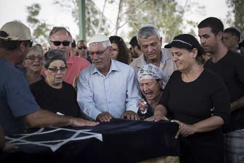 Grandparents of 4 year old Daniel Tragerman mourn during his funeral at the Hevel Shalom Cemetery in Southern Israel. The boy was murdered by Hamas.