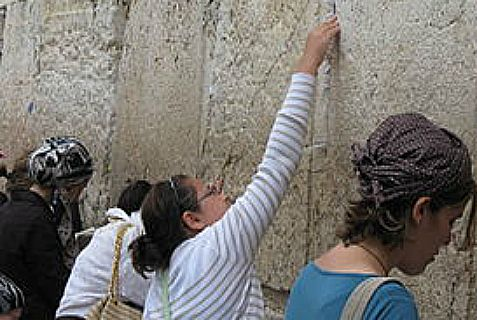 Eroding limestone make it easier to put notes in crevices in the Western Wall but also contribute to  its instability.