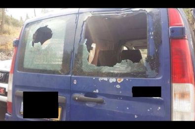 Damage to a car attacked by Arab road terrorists in the Jerusalem neighborhood of A-Tur, October 2, 2014.