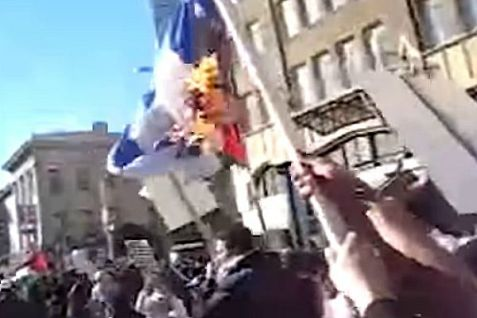 University campus group burns Israeli flag in demonstration.