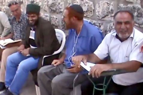 Yehuda Glick seen praying with Muslims. Glick is a proponent of the Temple Mount and coexistence.