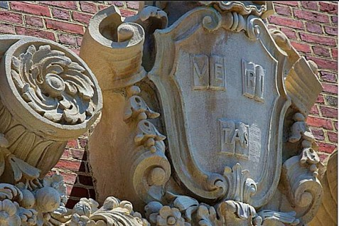 """The Harvard seal, """"veritas,"""" on the side of a Harvard building."""