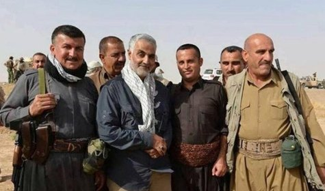 "Center, with scarf: Iranian Qods Force commander Gen. Qassem Soleimani, with local Iraqi military leaders in Iraq in 2014. A U.S. defense official said in 2013 that Soleimani was ""running the whole Syrian war by himself."" (Quoted by Dexter Filkins in ""Shadow Commander,"" The New Yorker, 30 Sep 2103. Image via Twitter)"