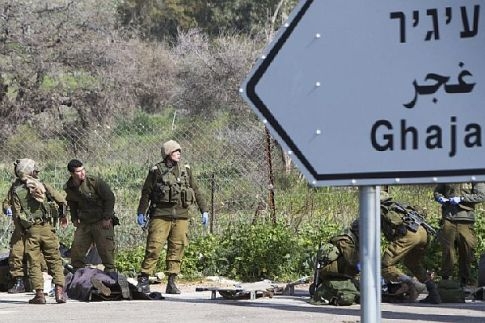 IDF soldiers evacuating wounded near northern border town of Ghajar.