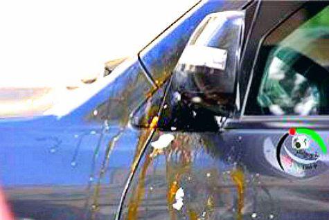 Baird's car splattered with eggs.